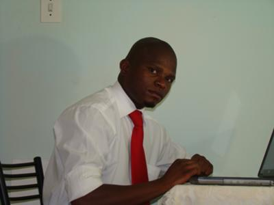 Hard at work: Mr. Justice Molafo, Senior Communication Manager.